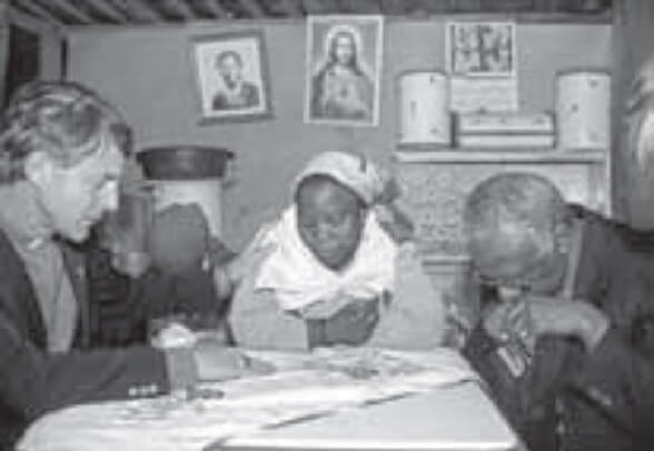 Archbishop Tutu (on the right) with a survivor of the massacre.