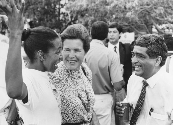 Photograph of Cheryl Carolus, UDF publicity secretary in the Western Cape (left); Black Sash President, Mary Burton (centre); and lawyer, Ibrahim Mohammed (right), share the news of the unbanning of the ANC, 2 February 1990. Doug Pithey / Independent Newspapers