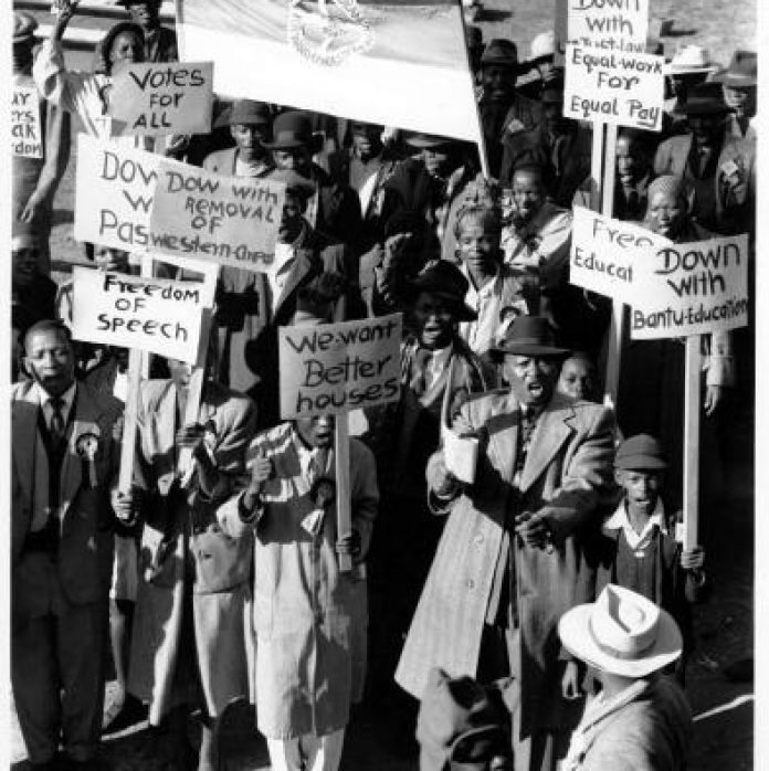 Supporters with placards at Congress of the People, Kliptown.
